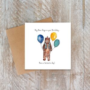Birthday card with a bear holding balloons